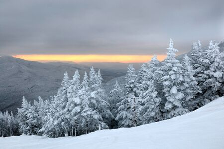 Sunset at ski slopes in winter mountains Stowe, VT  Archivio Fotografico