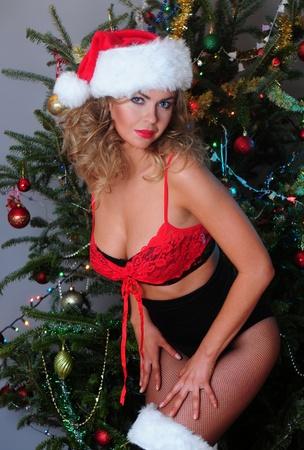 Beautiful blonde dressed as a very Santa Stock Photo