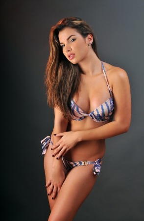 stunning: Pretty latino swimsuit fashion model posing in the studio