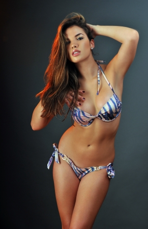 Pretty latino swimsuit fashion model posing in the studio photo