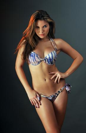 swimsuit model: Pretty latino swimsuit fashion model posing in the studio