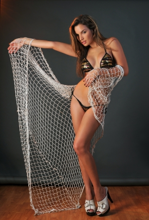 woman in bath: Pretty latino swimsuit fashion model posing in the studio