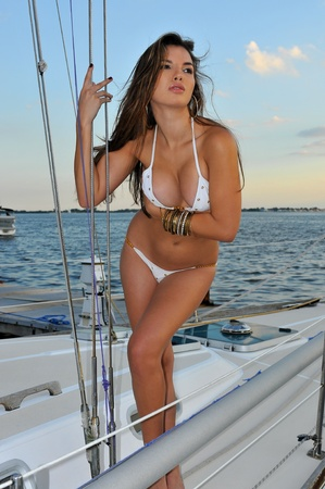 Pretty latin swimsuit fashion model posing sexy at boat marina location Stock Photo - 16577521