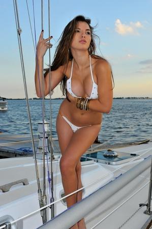 Pretty latin swimsuit fashion model posing sexy at boat marina location Stock Photo - 16577521