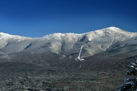 View to Mount Washington in New Hampshire from summit of Bretton woods ski area at early winter photo