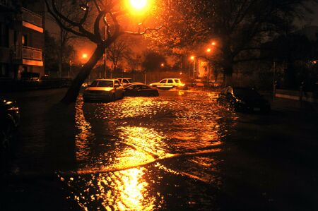 BROOKLYN, NY - OCTOBER 29: Flooded cars, caused by Hurricane Sandy, are seen on October 29, 2012, in the corner of Bragg street and  Shore Pway of Brooklyn NY, United States.