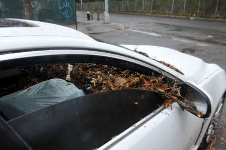 BROOKLYN, NY - OCTOBER 29: Debris litters inside abondoned cars in the Sheapsheadbay neighborhood due to flooding from Hurricane Sandy in Brooklyn, New York, U.S., on Tuesday, October 30, 2012.  