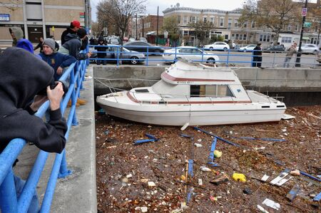 BROOKLYN, NY - OCTOBER 29: Debris litters the water in the Sheapsheadbay neighborhood due to flooding from Hurricane Sandy in Brooklyn, New York, U.S., on Tuesday, October 30, 2012.