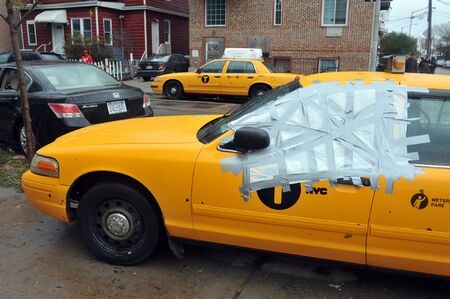 BROOKLYN, NY - OCTOBER 29: Yellow cabs all in mud in the Sheapsheadbay neighborhood due to flooding from Hurricane Sandy in Brooklyn, New York, U.S., on Tuesday, October 30, 2012.