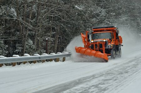 Snow removal vehicle removing snow after blizzard in New Hampshire, USA photo