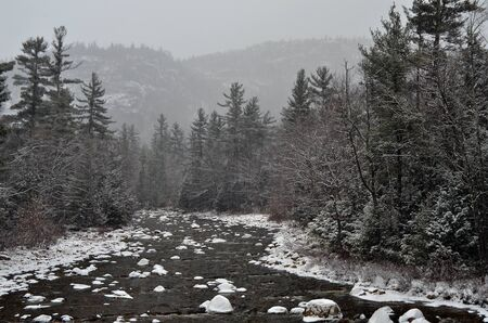 winter first snow scenery with mountain river in White Mountains, NH photo