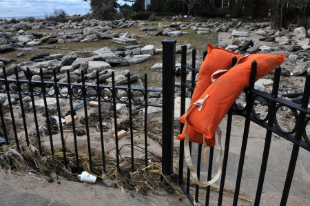 BROOKLYN, NY - NOVEMBER 01: Somebody's life jacket at the fence at the Manhattan beach neighborhood due to impact from Hurricane Sandy in Brooklyn, New York, U.S., on Thursday, November 01, 2012.