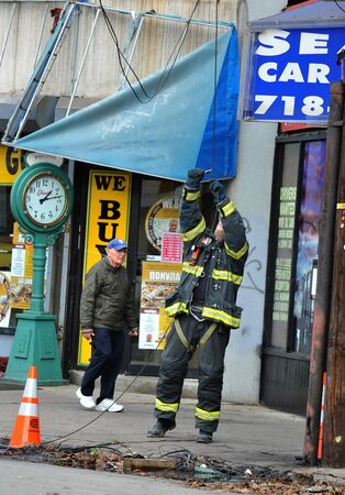 BROOKLYN, NY - NOVEMBER 01: NYFD fixing electrical wires  at the Brighton Beach neighborhood due to impact from Hurricane Sandy in Brooklyn, New York, U.S., on Thursday, November 01, 2012. Stock Photo - 16808772