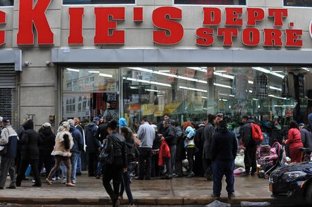 BROOKLYN, NY - NOVEMBER 01: Department store gives away to people wet merchandise at the Brighton Bwach neighborhood due to impact from Hurricane Sandy in Brooklyn, New York, U.S., on Thursday, November 01, 2012.   Stock Photo - 16816745