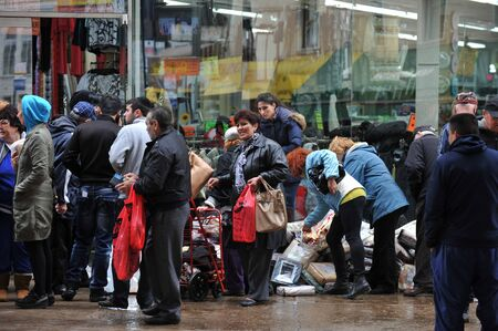 BROOKLYN, NY - NOVEMBER 01: Department store gives away to people wet merchandise at the Brighton Bwach neighborhood due to impact from Hurricane Sandy in Brooklyn, New York, U.S., on Thursday, November 01, 2012.  