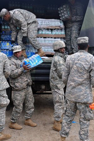 BROOKLYN, NY - NOVEMBER 01: US army helps peoples at the Seagate neighborhood wit Water and food due to impact from Hurricane Sandy in Brooklyn, New York, U.S., on Thursday, November 01, 2012.  