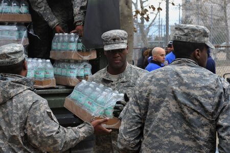 BROOKLYN, NY - NOVEMBER 01: US army helps peoples at the Seagate neighborhood wit Water and food due to impact from Hurricane Sandy in Brooklyn, New York, U.S., on Thursday, November 01, 2012.   Stock Photo - 16816710