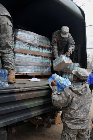 BROOKLYN, NY - NOVEMBER 01: US army helps peoples at the Seagate neighborhood wit Water and food due to impact from Hurricane Sandy in Brooklyn, New York, U.S., on Thursday, November 01, 2012.   Stock Photo - 16816729
