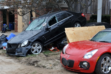 thursday: BROOKLYN, NY - NOVEMBER 01: Serious damage in the buildings nd cars at the Seagate neighborhood due to impact from Hurricane Sandy in Brooklyn, New York, U.S., on Thursday, November 01, 2012. Editorial