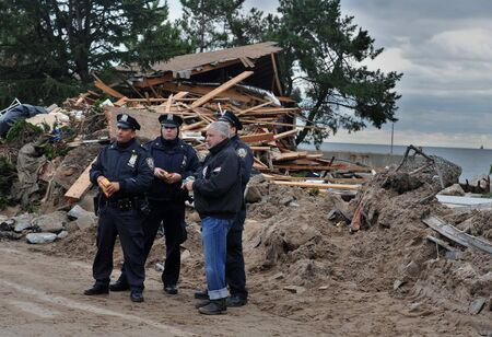 BROOKLYN, NY - NOVEMBER 01: NYPD secure serious damage in the buildings at the Seagate neighborhood due to impact from Hurricane Sandy in Brooklyn, New York, U.S., on Thursday, November 01, 2012.