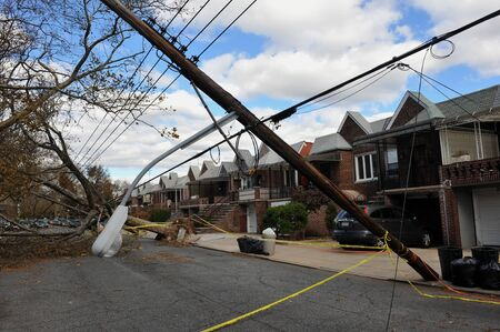 hurricane sandy: BROOKLYN, NY - NOVEMBER 03: Trees and electric poles felt down to the ground in the Sheapsheadbay neighborhood due to strong wind from Hurricane Sandy in Brooklyn, New York, U.S., on Tuesday, November 03, 2012.