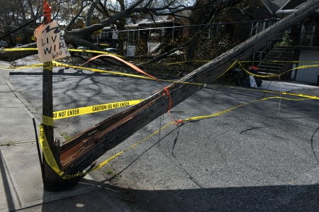 BROOKLYN, NY - NOVEMBER 03: Trees and electric poles felt down to the ground in the Sheapsheadbay neighborhood due to strong wind from Hurricane Sandy in Brooklyn, New York, U.S., on Tuesday, November 03, 2012.