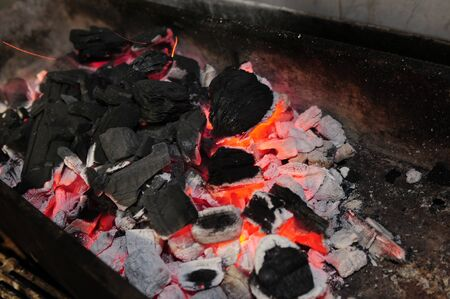 grill fireplace with coals burning down