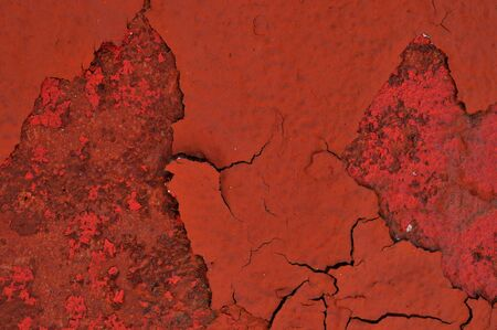 chipped red paint on rusty textured metal background  photo