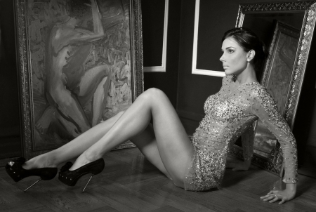 transparent dress: Pretty woman in vintage gown posing in room with antique painting and mirror