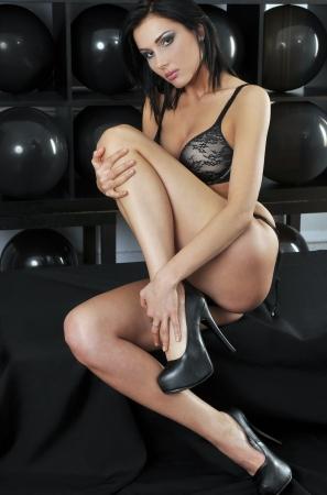 playboy: Playboy model pulling legs up