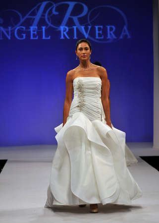 NEW YORK- OCTOBER 14: Models walks runway for Angel Riviera bridal show for Fall 2013 during NY Bridal Fashion Week on October 14, 2012 in New York City, NY