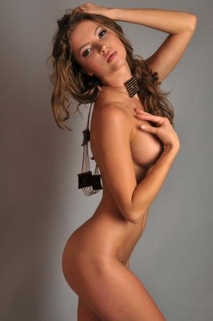 Young latin woman posing sexy in a studio Stock Photo - 18259943