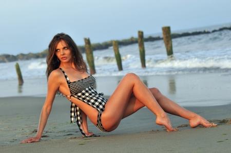 Sexy brunette woman posing in bikini on the beach Stock Photo