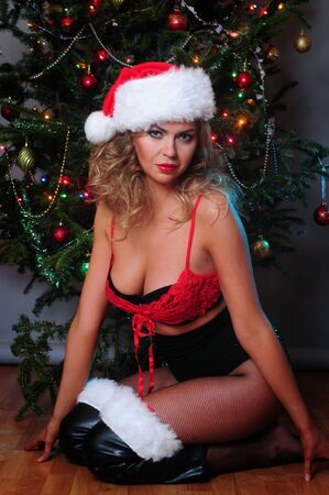 Beautiful blonde dressed as a very Santa