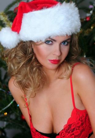 ass christmas: Beautiful blonde dressed as a very sexy Santa Stock Photo