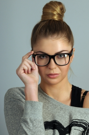 portrait of beautiful blond woman in glasses Stock Photo