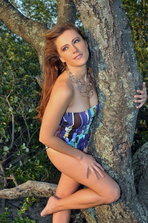 red head girl: beautiful young red head girl posing on the beach