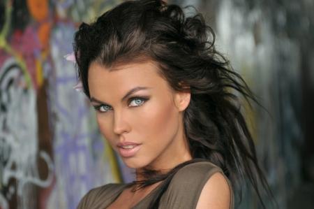 Portrait of fashion model at graffiti background