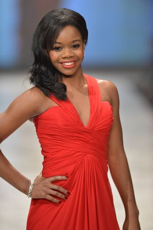 douglas: NEW YORK, NY - FEBRUARY 06: Gabrielle Douglas wearing Pamella Rolland walks the runway at The Heart Truth Editorial