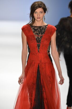 NEW YORK, NY- FEBRUARY 07: A model walks  the runway at the Tadashi Shoji  Collection for FallWinter 2013  during Mercedes-Benz Fashion Week on February 07, 2013 in NYC.