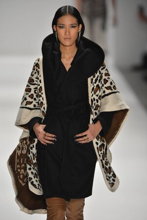 NEW YORK, NY - FEBRUARY 09: A model walks the runway at the Mara Hoffman show during Mercedes-Benz Fashion Week at The Stage at Lincoln Center on February 9, 2013 in New York City.