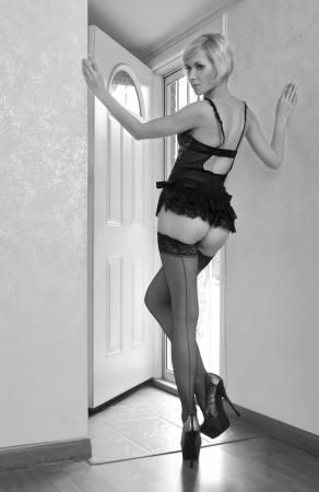 Sexy beautiful body shoot of young woman wearing black lingerie and stockings