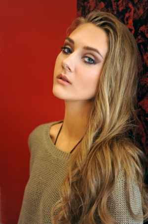 Portrait of beautiful blonde girl at beauty salon
