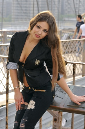 Fashion model posing sexy on Brooklyn Bridge in New York photo
