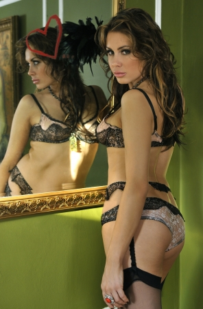 Sexy girl drawing a heart shape with lipstick on an antique mirror Stock Photo - 18324608