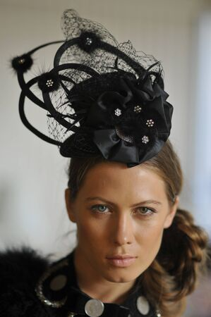 Model wearing designer hats and accessories