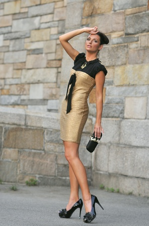 Fashion model posing outside in couture designer s dress photo