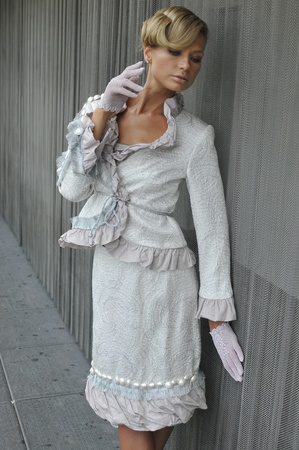 Fashion model wearing couture white costume and gloves photo