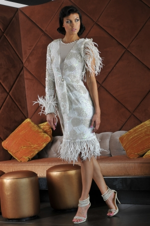 Fashion model posing in front of sofa bed in the restaurant lounge interior wearing couture designer dress photo