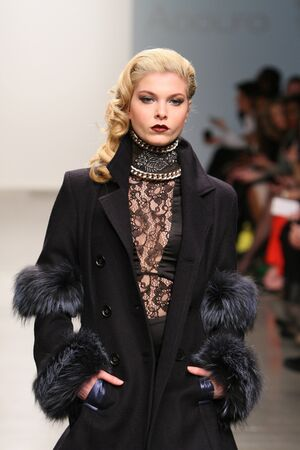 "NEW YORK - FEBRUARY 13: A model walks the runway at Adolfo Sanchez Fall Winter 2013 collection ""Alar"" during Nolcha Fashion Week on February 13, 2013 in New York City."